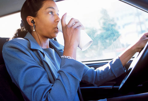 getty_rm_photo_of_woman_drinking_coffee_while_driving