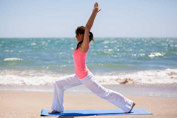 girl-yoga-on-beach